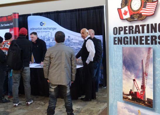 people gathering around Edmonton Exchanger booth