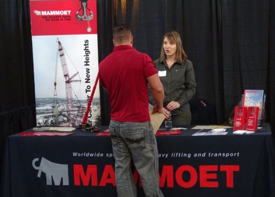 a man in a red shirt check out Mammoet booth
