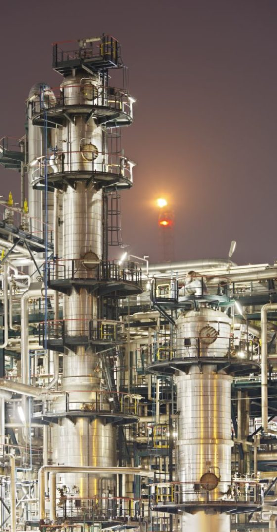 portrait photo of refinery-detail-at-night